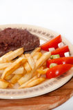 Beautiful served stuffed burger with fries Stock Images