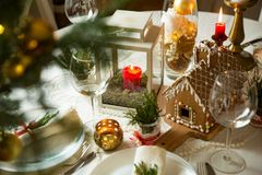 Beautiful served table with decorations, candles and lanterns Royalty Free Stock Photo