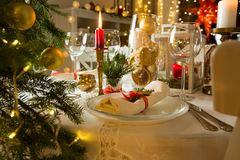 Beautiful served table with decorations, candles and lanterns Stock Photos