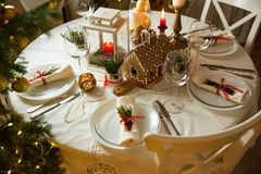 Beautiful served table with decorations, candles and lanterns Stock Photography