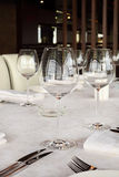 Beautiful serving at table with white tablecloth Stock Images