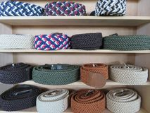 Beautiful set of belts of different models and colors stock photos