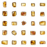 Beautiful set of 25 big golden-brown crystals of cane sugar isol Stock Photography
