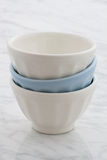 Beautiful set of bowls. Gorgeous cafe au lait bowls on top of carrara marble countertop Royalty Free Stock Image