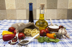 Beautiful set for the creation of the Sicilian pasta: cherry tomatoes, olive oil, balsamic sauce, garlic, spices, sea salt, salad Royalty Free Stock Photos