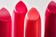 Beautiful set of lipsticks in red colors. Beauty cosmetic collection. Fashion trends in cosmetics with bright lips Stock Images