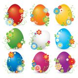 Beautiful set of shining eggs. Beautiful set of shining easter eggs in rainbow color decorated with flowers Stock Photos