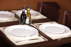 Beautiful set table with four plates stock photos