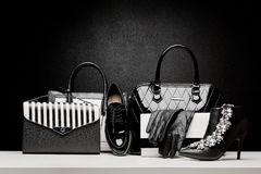 Beautiful set of women's fashion accessories on black background. Sexy and fashionable set of glamour black and white accessories for woman Stock Image