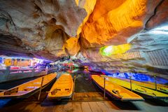 The beautiful Seven Star cave with colorful lights and reflection at Seven-star Crags Scenic Area. Zhaoqing, DEC 30: The beautiful Seven Star cave with colorful royalty free stock images