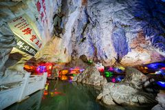 The beautiful Seven Star cave with colorful lights and reflection at Seven-star Crags Scenic Area. Zhaoqing, DEC 30: The beautiful Seven Star cave with colorful stock photos
