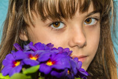 Beautiful seven year old girl portrait with flowers Royalty Free Stock Photo
