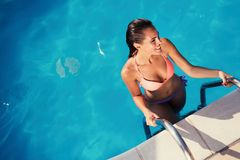 Beautiful sex girl enjoying summer vacation. In swimming pool Stock Image