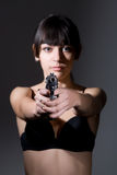 Beautiful sexual girl brunette with gun Stock Images