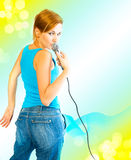 Beautiful sexual girl with a microphone Stock Photos