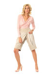 Beautiful sexual model blonde pose in fashion breeches. Beautiful sexual woman blonde pose in fashion breeches Royalty Free Stock Image