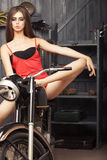 Beautiful sexual young girl om motorbike Stock Images
