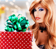 Beautiful sexy adult  woman with a birthday gift red box Royalty Free Stock Photos
