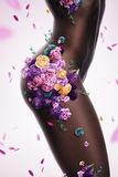 Beautiful sexy afro woman with flowers on body Stock Photography