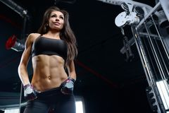 Sexy athletic young girl working out in gym Stock Photo
