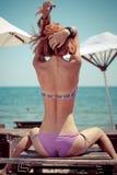 Beautiful sexy bikini girl outdoors by blue sea Stock Photos