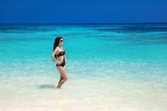 Beautiful bikini model. Tropical beach. Outdoor portrait of stock photo