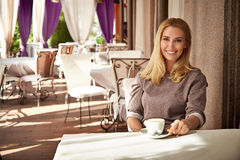 Beautiful sexy blond business woman restaurant drink coffee tea Stock Images