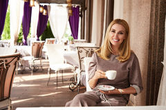 Beautiful sexy blond business woman restaurant drink coffee tea Stock Photography
