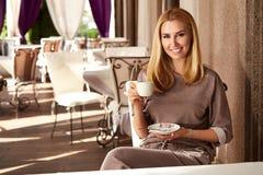 Beautiful sexy blond business woman restaurant drink coffee tea Stock Photos