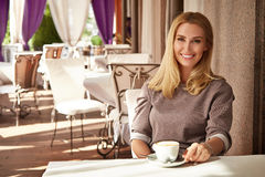 Beautiful sexy blond business woman restaurant drink coffee tea Royalty Free Stock Images