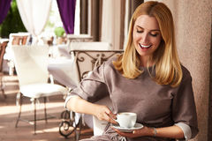 Beautiful sexy blond business woman restaurant drink coffee tea Stock Image
