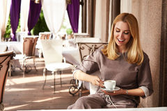 Beautiful sexy blond business woman restaurant drink coffee tea Royalty Free Stock Image