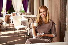 Beautiful sexy blond business woman restaurant drink coffee tea Royalty Free Stock Photography