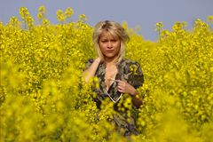 Beautiful sexy blond Girl in the blossom Rape Fiel Royalty Free Stock Images