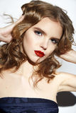 Beautiful sexy blond girl with make up red lips. Closeup of the face belong to beautiful young sexy blonde girl with curly hair pure snow white skin and bright Stock Images