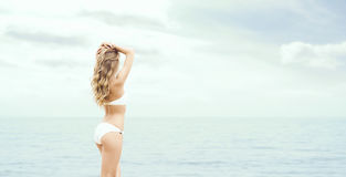 Beautiful, sexy blond posing on the beach. Stock Images