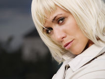 Beautiful sexy blond woman in coat. Closeup of beautiful sexy blond woman in coat Royalty Free Stock Photos