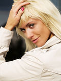 Beautiful sexy blond woman in coat Royalty Free Stock Photos