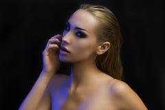 Beautiful Sexy Blond Woman. Dark Background. Bright Smokey Eyes Royalty Free Stock Photo