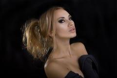 Beautiful Sexy Blond Woman. Dark Background. Smokey Eyes Makeup Royalty Free Stock Photo