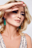 Beautiful sexy blond woman dress luxary party jewelry makeup Royalty Free Stock Image