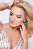 Beautiful sexy blond woman dress luxary party jewelry makeup Stock Images
