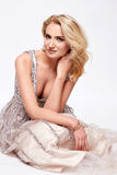 Beautiful sexy blond woman dress luxary party jewelry makeup Royalty Free Stock Photos