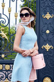 Beautiful blond woman makeup wear stylish short dress. For party and walk glamour fashion clothes silk shawl accessory bag and sunglasses good summer weather stock image