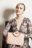Beautiful sexy blond woman sitting on  chair Royalty Free Stock Images
