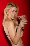 Beautiful sexy blond young woman in bikini drinking juice Royalty Free Stock Image