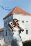 Beautiful sexy blonde bride posing outdoor, castle background Royalty Free Stock Images