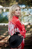 Beautiful sexy blonde cowgirl. In the countryside Royalty Free Stock Photo