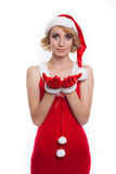 Beautiful blonde female model dressed as Santa Claus in a r Stock Images