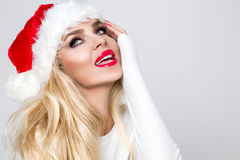 Beautiful sexy blonde female model dressed as Santa Claus in a r Royalty Free Stock Photo
